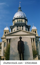 State Capitol Building of Illinois with the statue of Abraham Lincoln in the foreground