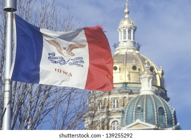 State Capitol of Iowa and state flag in Des Moines, Iowa
