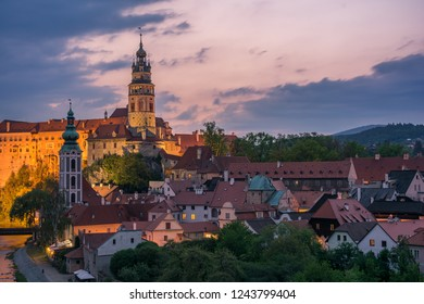 State Castle and Chateau, St. Jost church and city view of Český Krumlov with twilight sky taken from Vltava riverside