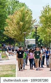 State College, Pennsylvania, August 10, 2016 - New foreign students enrolled at Penn State University participate in an International Student Orientation during a tour of its main campus.
