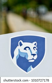 State College, Pennsylvania, August 10, 2016 - Close-up of Penn State's Nittany Lion masot on a sign on the main campus of the university.