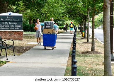 State College, Pennsylvania, August 10, 2016 - Students move personal belongings into their dormitories on move-in day at the main campus of Penn State University.