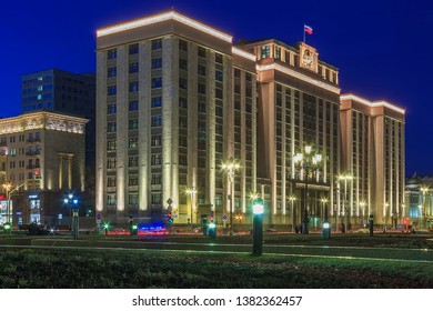 State Duma (Gosduma) is lower house of Federal Assembly of Russia, upper house is Council of Federation. Okhotny Ryad Street, Moscow. Facade of Building of State Duma. Evening lighting. Moscow 03/2019