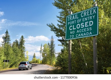 STATE HIGHWAY 486, MONTANA, USA: September 9, 2018: An SUV drives past a sign stating the Trail Creek Port of Entry is closed with no access to Canada