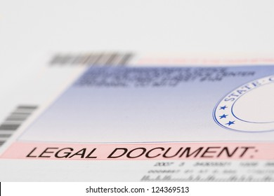 A State Legal Document envelope, with shallow depth of field.
