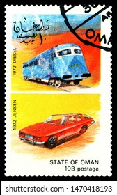 STATE OF OMAN - CIRCA 1972: A stamp printed in State of Oman shows antique locomotive Diesel 1972  and car Jensen 1972, series, circa 1972