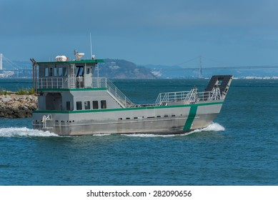 A state park research ship motors out into San Francisco Bay