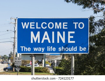 state sign maine at the highway with welcome greeting