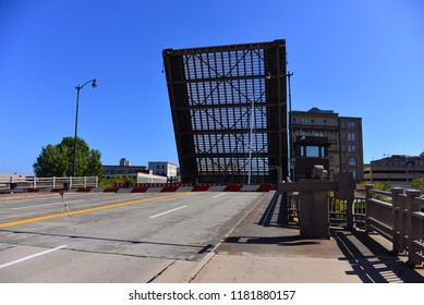 The State Street bridge in an open position letting a sailboat through.