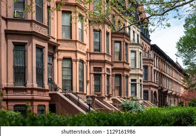 Stately and beautiful brownstone homes along a street in Brooklyn New York USA