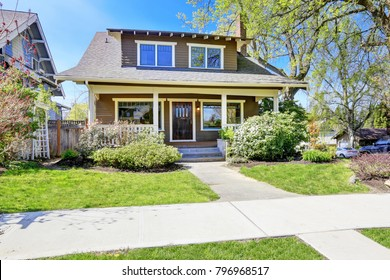 Stately completely renovated Craftsman home exterior. This historic home was designed and constructed by Henry Schneider.