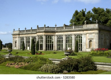 A stately home in a glorious garden