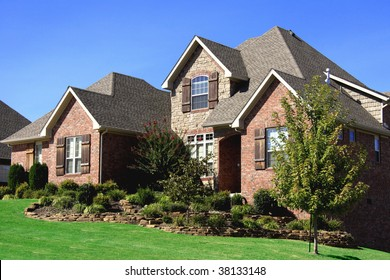 Stately nicely landscaped upscale brick home somewhere in the midwest USA.