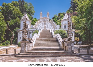 A stately staircase to the Sanctuary of Bom Jesus do Monte, symbolizing the way of Christ's cross, against the blue sky on a bright sunny day, Braga, Portugal.