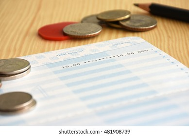 Statement account and Saving book bank with pen and coin for Business financial and loan