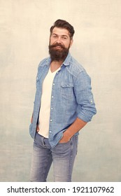 Statement denim jacket. Mature hipster with beard. Denim shirt essential garment modern wardrobe. Clothes shop model. Male casual style. Denim look. Brutal hipster with mustache. Barbershop client.