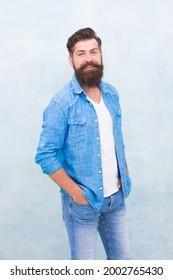 Statement denim jacket. Mature hipster with beard. Denim shirt essential garment modern wardrobe. Clothes shop model. Male casual style. Denim look. Brutal hipster with mustache. Barbershop client
