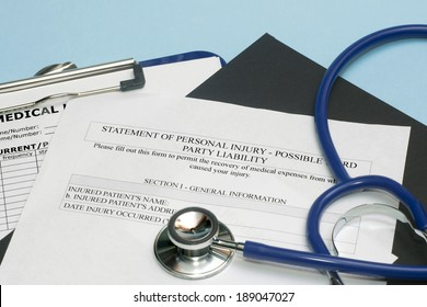Statement of personal injury form with patient chart and stethoscope.