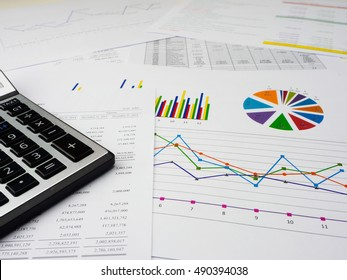 Statements of financial position.information with financial and sale graph.calculator,graph and pen on the desk.closeup graph on the table