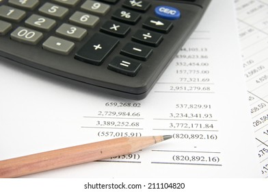 Statements of income include sales with pencil and black calculator. Business and finance concepts rich and successful photography.