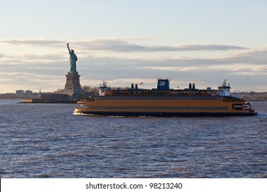Staten Island Ferry cruises past the Statue of Liberty in New York City, NY