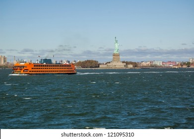 Staten island Ferry Passing Liberty Island on a Clear Autumn Day