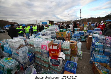 STATEN ISLAND, NEW YORK CITY - NOVEMBER 4 2012:Volunteers & national guard assembled at New Dorp High School to render aid to people recovering from Hurricane Sandy.Stacks of water ready to distribute