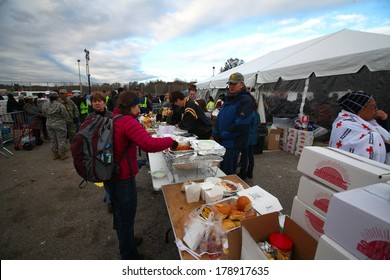 STATEN ISLAND, NEW YORK CITY - NOVEMBER 4 2012: Volunteers & national guard assembled at New Dorp High School to render aid to people recovering from Hurricane Sandy. Food supplies distributed