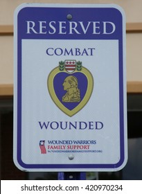 STATEN ISLAND, NEW YORK - MAY 15, 2016: Combat Wounded Reserved sign in Staten Island. Wounded Warriors Family Support provides support to the families of those who have been wounded,injured or killed