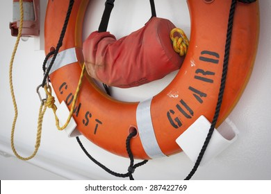 STATEN ISLAND, NY - MAY 24 2015: An orange lifering mounted to the wall of the USCGC Spencer (WMEC 905) a Medium endurance cutter at Sullivans Pier during Fleet Week NY 2015.