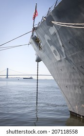 STATEN ISLAND, NY - MAY 25, 2014: The bow of the guided-missile destroyer USS Cole (DDG 067) moored during Fleet Week NY at Sullivans Piers with the Verrazano-Narrows Bridge in the background.