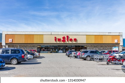 STATESVILLE, NC, USA-2/14/19: Ingles is a North Carolina-based supermarket chain, with over 200 locations in the southeast United States.  Images shows store front, parking lot, and two people.