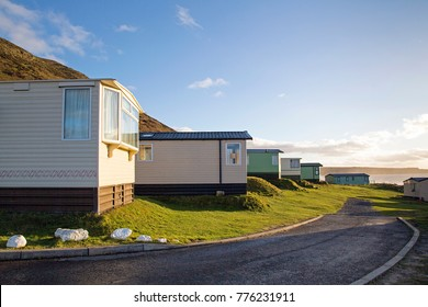 Static caravan holiday homes at Llangennith on the Gower Peninsular in winter which is out of season, the caravans are closed up until spring