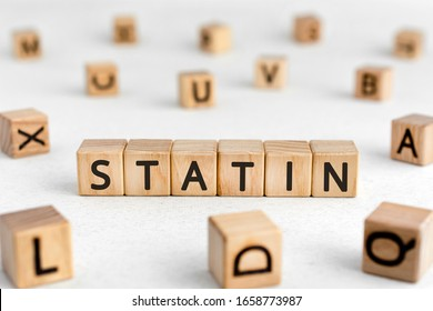 Statin - words from wooden blocks with letters, cholesterol level reduces drugs statin concept, white background