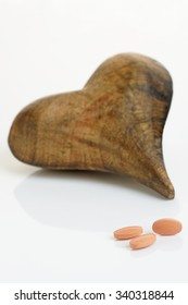 Statins or other heart medication with a wooden heart. Healthcare concept.Shallow d o f