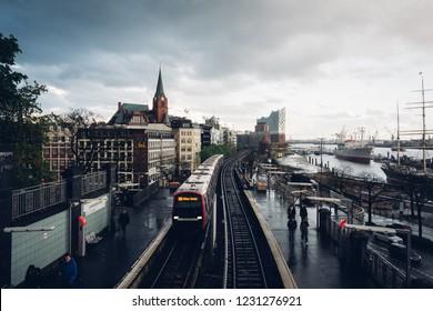Landungsbrücken station with dark cloudy sky taken from Stintfang Aussichtsplattform, Hamburg, Germany, 26th April 2018