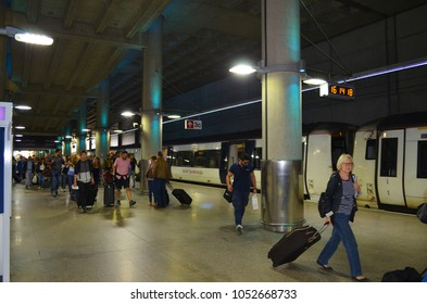 Station London Stansted with arriving passengers and the Stansted Express in background - London, Great Britain - 08/04/2015