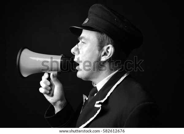 Station master with megaphone