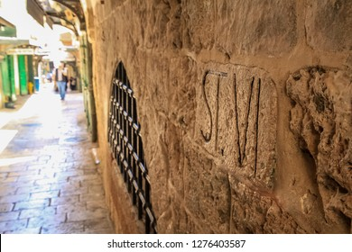 "Station VI carved into wall in Jerusalem on Via Dolorosa, which means, ""Path of Pain""."