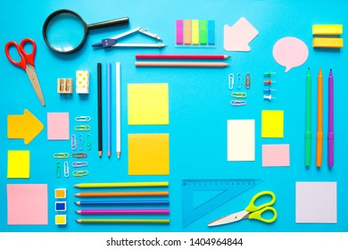 Stationary, back to school, summer time, creativity and education concept. Supplies- Scissors, pencils, paper clips, note, stapler and notepad, globe on colorful background, flatlay. Mock up. Top view