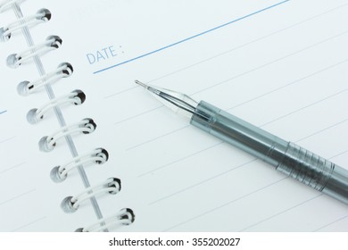 Stationary pen and book white background