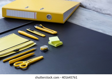 Stationery background - Group of stationery tools on leather wood background