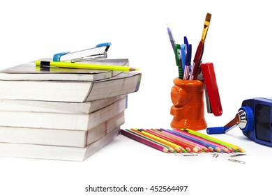 Stationery background - Group of stationery tools - sharpener, color pencils, notebooks, pens, brushes on white background