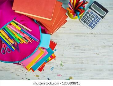 Stationery with copyspace. Group of school supplies and books on table