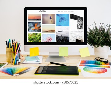 Stationery desktop with design stuff, computer and graphic tablet. photo porfolio.