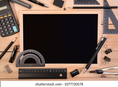 Stationery of education for mathematics class in school. Mathematics equipment tools for basic math with calculator and empty blackboard.