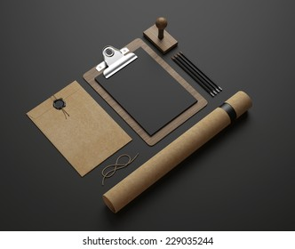 Stationery elements on black paper background