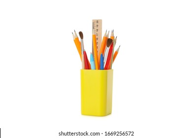 Stationery in holder isolated on white background
