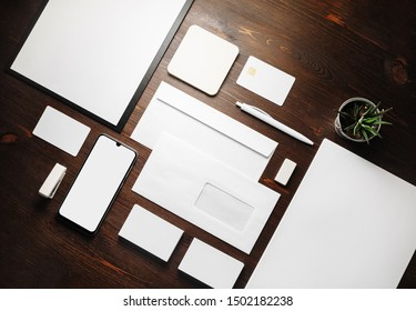Stationery mock up. Blank corporate identity template on wood table background. Responsive design mockup. Flat lay.