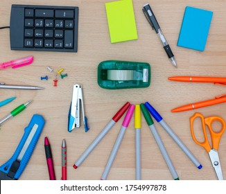 Stationery and office supplies, school supplies on wooden background.